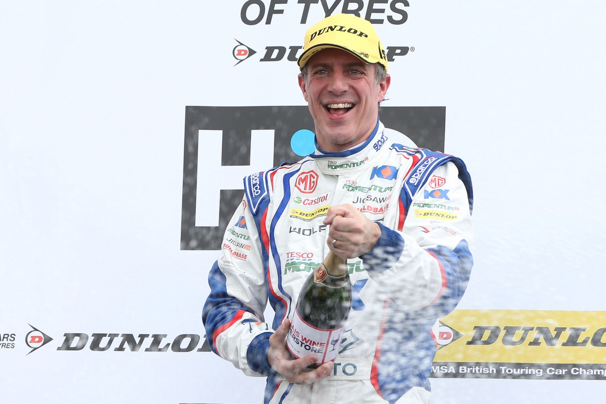 Jason Plato celebrating with champagne at Brands Hatch