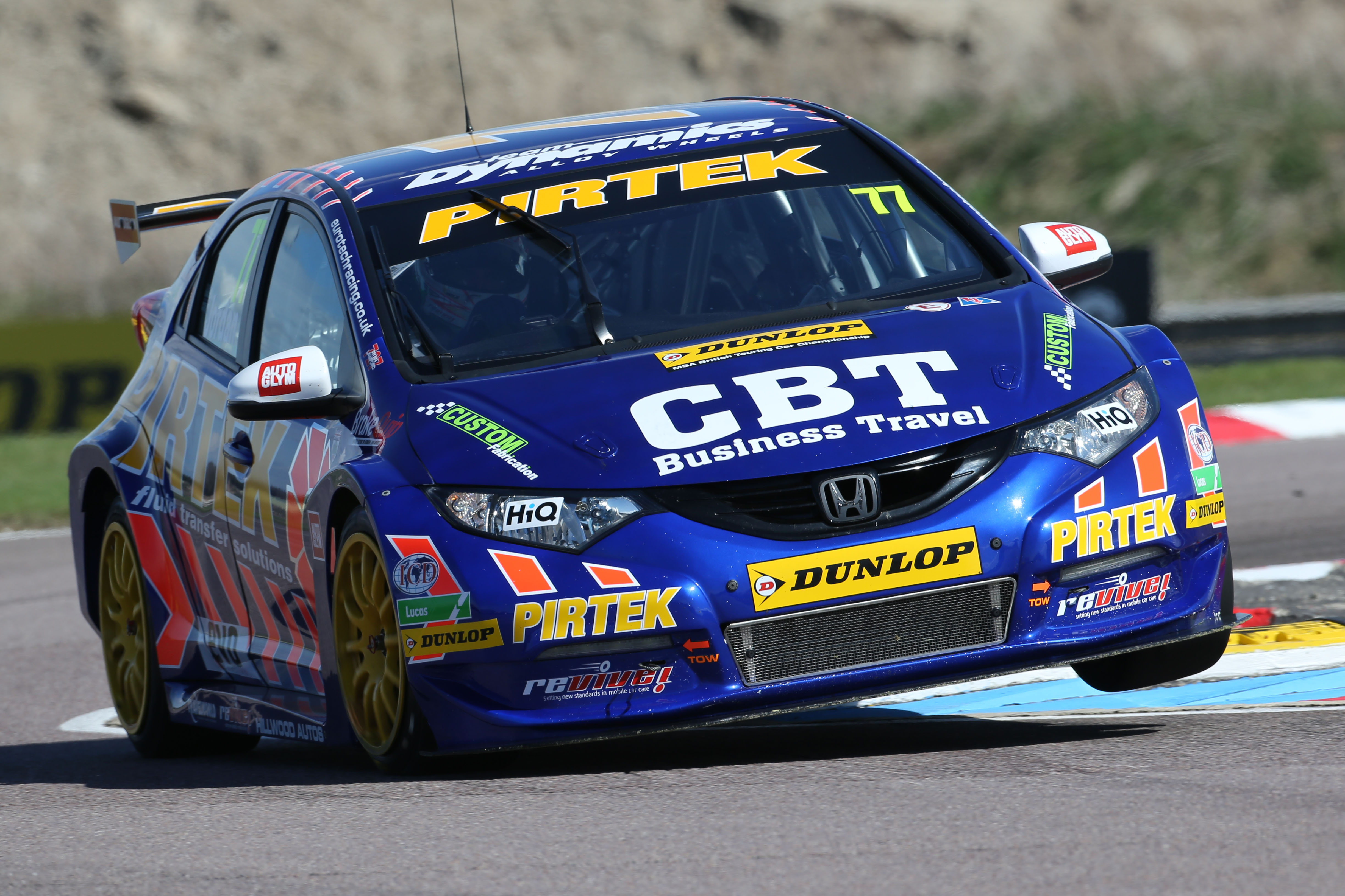 Andrew Jordan attacks the kerbs on his way to pole position